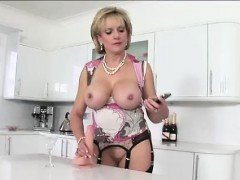 Lady Sonia rubs dildo with...